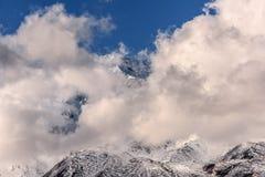 Mountains snow glacier clouds Stock Image