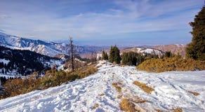 In the mountains. Snow lies on a hillside in Kimasarovskoe canyon, mountains of Trans-Ili Alatau district of Almaty Stock Photo