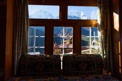 Mountains snow peaks buddhist monastery window view, Nepal. Stock Photos