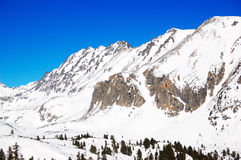 Mountains with snow at Strebske Pleso ski resort Stock Photos