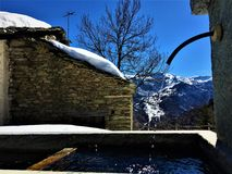 Mountains, snow and water. Mountains, snow, fountain, water, winter, view and nature royalty free stock photos