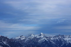 Mountains. Snowy mountains in winter with a cloudy sky Stock Photography