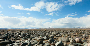 Mountains, the steppe and the sky Royalty Free Stock Image