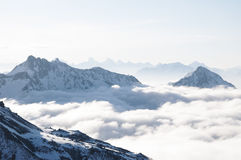 Mountains sticking out of clouds Royalty Free Stock Photo