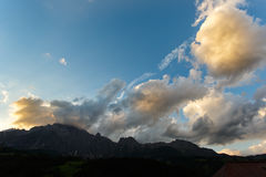 Mountains stone peaks with orange clouds under sunset light. Austria, Europe Royalty Free Stock Photos