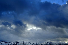 Mountains with Stormy Sky During Winter Royalty Free Stock Photography
