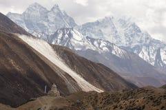 Mountains and Stupa. Great Himalayan mountains and small old Buddhist Stupa Royalty Free Stock Photo