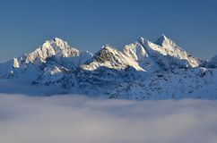 Mountains summits over clouds. Winter mountains summits in polish tatra Royalty Free Stock Photography
