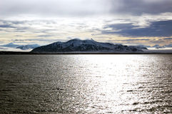 Mountains with sun and clouds in Spitsbergen, Svalbard, Norway. Royalty Free Stock Photos