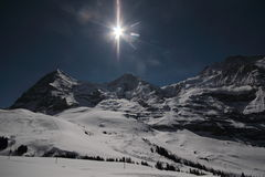Mountains with the sun. Mountains with a deep blue sky covered in Snow Stock Photo