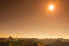 Mountains and sun in the sky Royalty Free Stock Images
