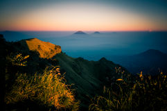 Mountains in sunlight. Photo of Mt. Merbabu and surrounding mountains in sunlight during sunrise near Yogya in central Java province in Indonesia. In this region Royalty Free Stock Photography
