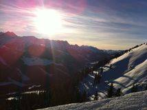 Mountains and Sunlight. Sun shinning bright on beautiful, snowy mountains Royalty Free Stock Photos