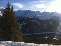 Mountains and Sunlight. Sun shinning bright on beautiful, snowy mountains Stock Photos