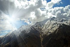 Mountains sunny spring day. Sunny spring day snow covered mountains royalty free stock photos