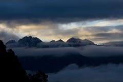 Mountains in Sunrise. Faraway mountains in Sunrise, Yubeng, Shangri-La Royalty Free Stock Photos