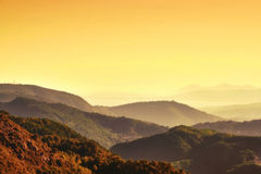 Mountains and sunrise. Sunrise over hilly terrain in southern France Stock Photo