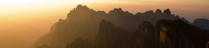 Mountains in Sunset. The sun sheds its last light on the mountains Royalty Free Stock Photo