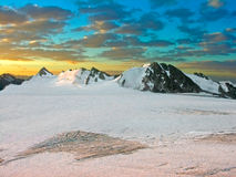 Mountains on a sunset. The snow-covered mountains lighted by a sunset Stock Image
