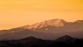 Mountains at sunset with snow Royalty Free Stock Photo