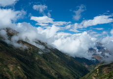 Mountains Surrounded by Clouds Under White and Blue Sky at Daytime Stock Photography