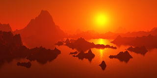 Mountains surrounded by water at sunset. Royalty Free Stock Image