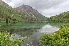 Sultry skies and reflections, St. Elias Lake, Kluane National Park Stock Photo