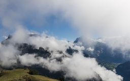 Mountains in Switserland Alps. Alps and Mountains in Switserland with clouds and blue sky Royalty Free Stock Image