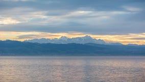 Mountains in Switzerland from Langenargen. During sunset Stock Photo