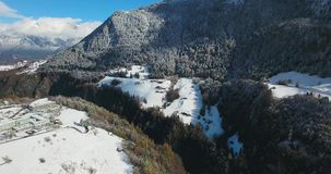 Mountains in switzerland at winter time aerial view stock footage