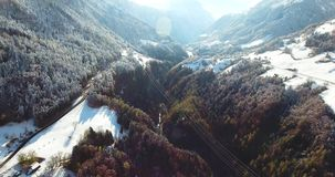 Mountains in switzerland at winter time aerial view stock video footage