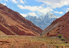 Mountains of Tajikistan. The road in the middle of red mountains in Tajikistan Stock Image