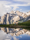 Mountains and tent reflecting in lake Royalty Free Stock Images