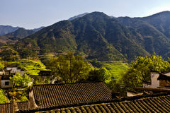 Mountains and terraced old building Royalty Free Stock Photos