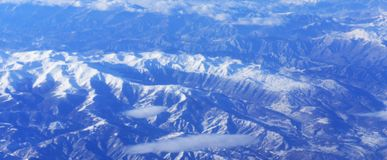 Mountains from the top. A picture of white snowy mountains from an aerial view,in paris france,in a cold morning of december Stock Images