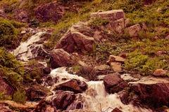 It is in the mountains of Trans-Ili Alatau. Weather changes frequently in the mountains of Trans-Ili Alatau spring Stock Image