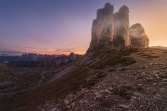 In the mountains Tre Cime di Lavaredo at sunset. Stock Photography