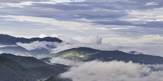 Mountains trees clouds cool weather. Mountains trees clouds cool a weather stock image