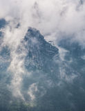 Mountains with trees and fog Stock Images