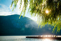 Mountains Trees River. River, mountains and dock with sun shining through the trees from Cold Spring NY royalty free stock photography