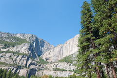 Mountains, trees and waterfall in Yosemite Stock Images