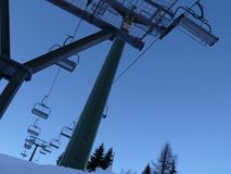 Trentino, Italy. 01/03/2011. Chairlift in the mountains of the Dolomites stock photos