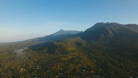 Mountains with tropical forest. Camiguin island Philippines. Mountains with rainforest covered with green vegetation and trees on the tropical island, landscape stock video footage