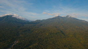 Mountains with tropical forest. Camiguin island Philippines. Mountains with rainforest covered with green vegetation and trees on the tropical island, landscape stock video