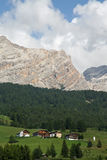 Mountains and Tyrolean houses Royalty Free Stock Photo