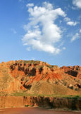 Mountains under blue sky. Colorful mountains under blue sky and white clouds besides dry Yellow River in North China Stock Photos