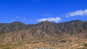 Mountains under blue sky. In Gansu,China Royalty Free Stock Photo