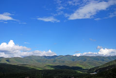 Mountains under blue sky Stock Image