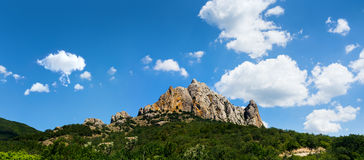 Mountains under the blue sky Stock Image