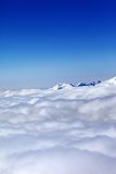 Mountains under clouds and clear blue sky Royalty Free Stock Photography